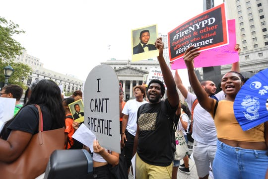 Activists hold a rally in Foley Square in New York City on July 17, 2019. The Department of Justice announced the day before that New York Officer Daniel Pantaleo would not face federal charges in Garner's death.