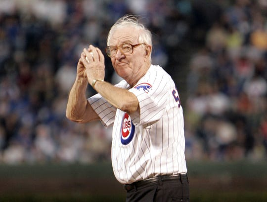 John Paul Stevens winds up to throws out the first pitch before a 2005 game at Wrigley Field.