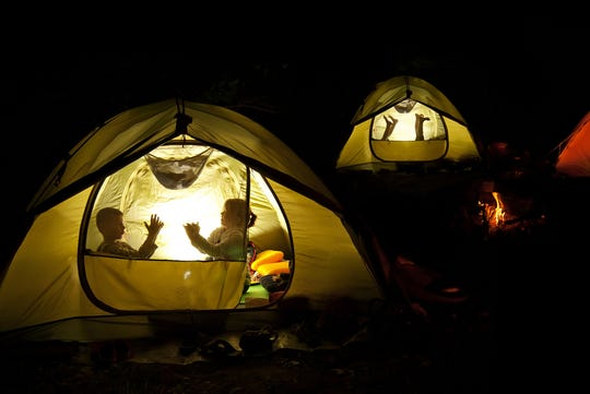 Put on a shadow puppet show during your next campout.