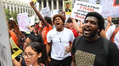 People participate in a protest to mark the five-year anniversary of the death of Eric Garner on July 17, 2019 in New York. Garner died after a confrontation with a police officer in the borough of Staten Island. The Department of Justice announced on July 16, 2019 to not pursue civil rights charges against NYPD officer David Pantaleo, who put the 43-year-old black manin achokehold.