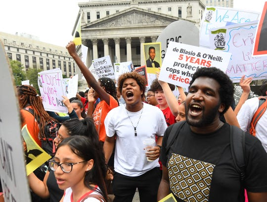 People participate in a protest to mark the five-year anniversary of the death of Eric Garner on July 17, 2019, in New York.