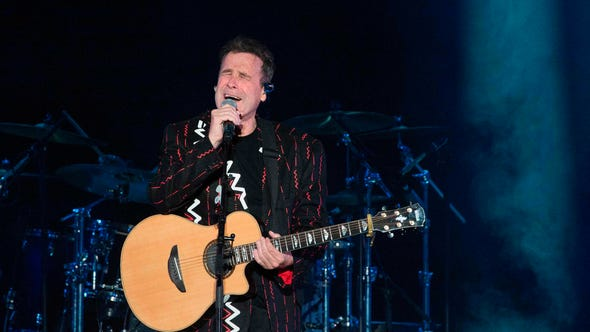 (FILES) In this file photo taken on June 30, 2017 Johnny Clegg performs at Grandwest Arena in Cape Town on the first live gig of his final world tour, after which he is expected to retire. - South African legendary singer Johnny Clegg, who blended Zulu rhythms with Western styles, died on July 16, 2019, after a long battle with cancer, his manager said. Clegg succumbed to pancreatic cancer at the age of 66 at his home in Johannesburg, more than four years after he was diagnosed. (Photo by RODGER BOSCH / AFP) / ==  RESTRICTED TO EDITORIAL USE / NO COMMERCIAL / NO RESALE TO THIRD PARTY ==RODGER BOSCH/AFP/Getty Images ORIG FILE ID: AFP_1IU64B