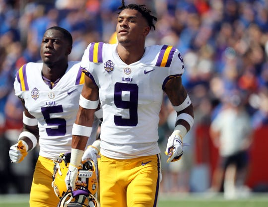 LSU safety Grant Delpit (9) goes through warmups before the Tigers play Florida in 2018.