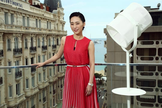 In this May 21, 2019, photo, actress Wu Ke-xi poses for portrait photographs at the 72nd international film festival, Cannes, southern France.