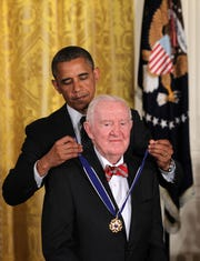 Former Supreme Court Justice John Paul Stevens is presented with a Presidential Medal of Freedom by President Barack Obama on May 29, 2012, at the White House in Washington.