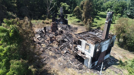An overnight fire ripped through an abandoned home set back off Norwood Avenue in West Long Branch Tuesday, July 16, 2019.  The century-old mansion was the former home of the late mayor Henry J. Shaheen, according to officials and Monmouth County property records.