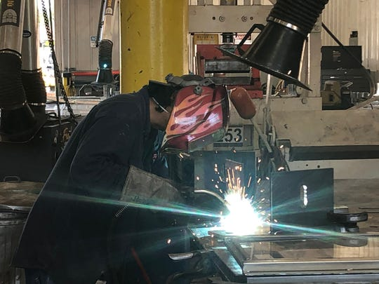 Jef Verjara, a welding fabricator at Freehold Welding, works on a bridge component.