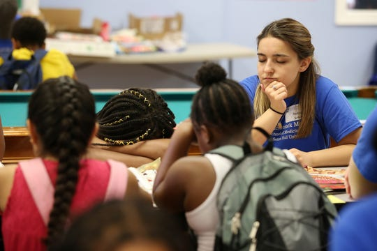 Melissa Arfuso of Clifton Park, a student from Hackensack Meridian Health Medical School at Seton Hall, meditates with a group of children during a visit to the Boys and Girls Club of Asbury Park in Asbury Park, NJ Tuesday July 9, 2019. Students from Hackensack Meridian Health Medical School at Seton Hall are fanning out into communities to figure out ways to improve health beyond the traditional doctors' offices.