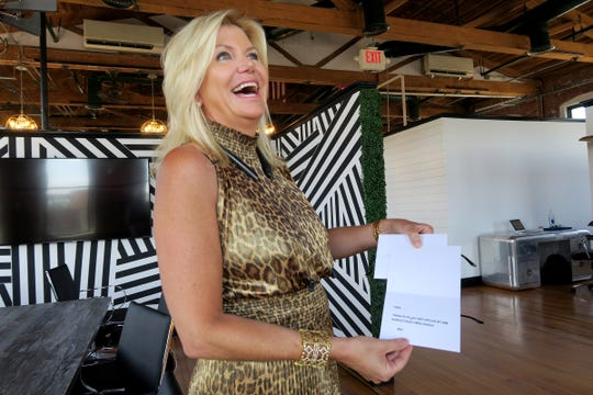 CBD For Life owner Beth Stavola smiles as she holds one of the cards given to her employees during an interview in her office at the the Galleria in Red Bank Monday, July 15, 2019.  The company was recently acquired by a New York City cannabis company for $10.4 million.