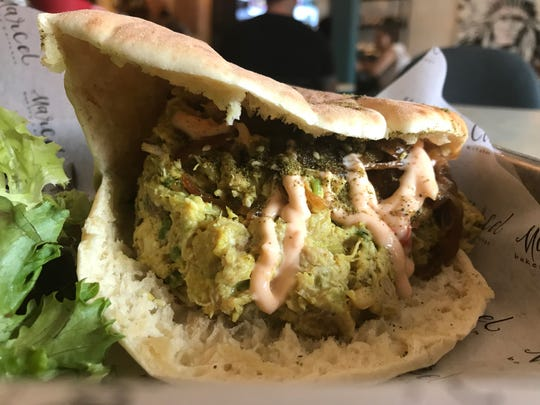 The curry chicken salad from Marcel Bakery in Montclair comes chilled and wrapped in a warm pita.