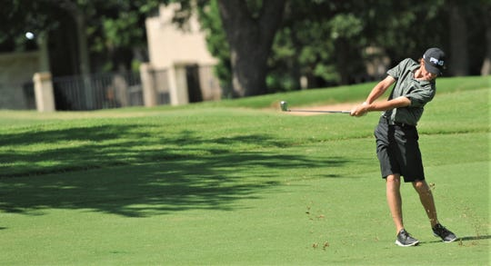 Abilene's Karson Grigsby hits from the fairway at No. 5 during the final round of the AJGA Folds of Honor hosted by Bob Estes golf tournament Thursday, July 18, 2019, at the Abilene Country Club's South Course. Grigsby, who will be a sophomore at Cooper, started the day tied with Keaton Vo for the lead with a two-day total 139.