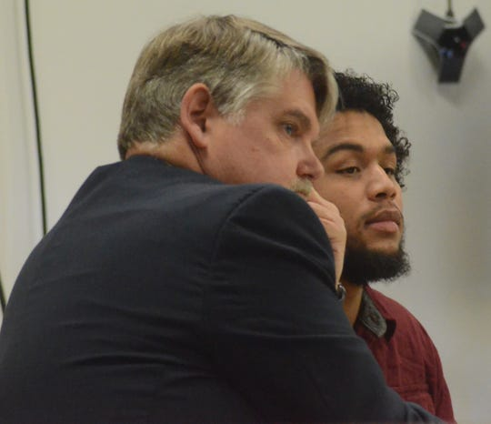 Jarvis Brown with his attorney, Niels Magnusson before Brown testified.