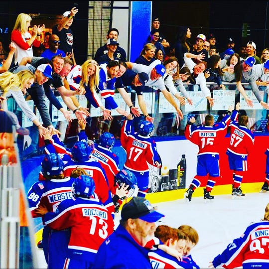 Chenango Valley fifth-grader Robbie Matson, second from right, and his Connecticut Junior Rangers teammates are congratulated by fans after winning the Brick International Hockey Tournament on July 7 at Edmonton, Alberta.