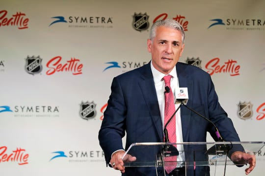 Ron Francis talks to reporters, Thursday, July 18, 2019, in Seattle after he was introduced as the first general manager for Seattle's yet-to-be-named NHL hockey expansion team.