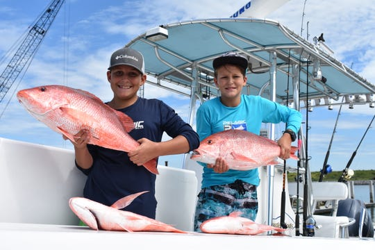 Colton and Wyatt Hawkins of Melbourne, back at the Freddie Patrick Park boat ramps at Port Canaveral, show off four of seven red snapper that their family caught July 12, on the first day of the 2019 Federal Atlantic Recreational Red Snapper Season. The family reeled in its limit of the prized food and game fish in waters about 30 miles east of the Port.