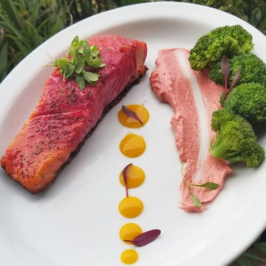Josh Haggerty, the new executive chef at The Shack, creates artful dishes such as this beet-cured salmon with cherry almond butter and mango puree with fresh steamed broccoli.