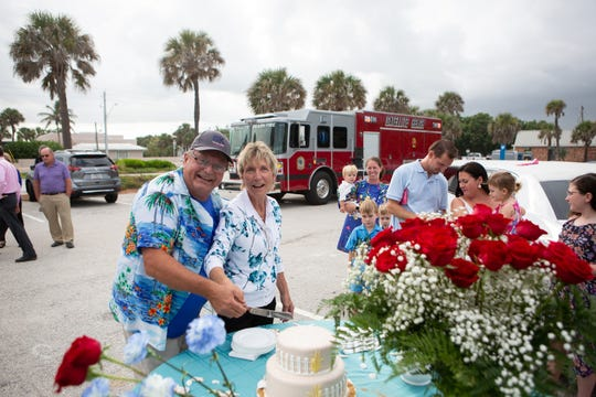 Cindy and Pete Rogell cut a cake at their 40th anniversary party at Pelican Beach Park -- a surprise party Pete planned down to having Cindy, bakery manager at Publix in Viera, arrive thinking she was delivering a cake for a wedding at the beach.