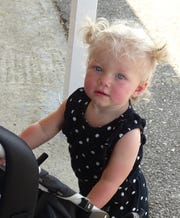 Kylie Dick, 1, enjoys her visit to the Crawford County Fair.