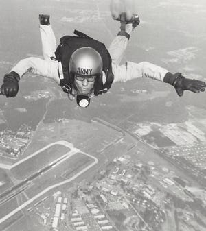 Tad started sky diving for fun with his brother. The hobby would later lead him to jump with the Army. He is pictured here over Fort Bragg in North Carolina.