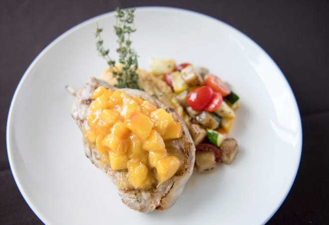 Grilled prime pork chop with Jersey peach marmalasde, creamy polenta, and ratatouille is a dish on the SJ Hot Chefs Farm To Fork Restaurant Week menu of Anthony's Creative Italian Cuisine in Haddon Heights.