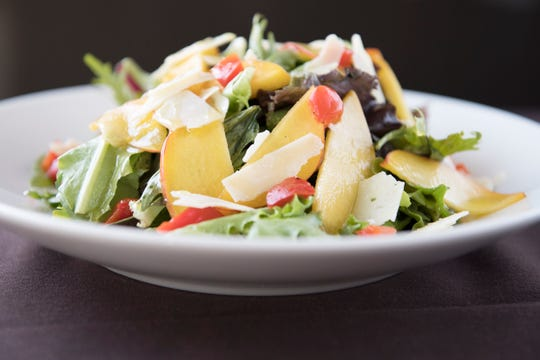 Jersey peach salad with grilled peppers, shaved asiago cheese, field greens, and orange vinaigrette dressing is a dish on the SJ Hot Chefs Farm To Fork Restaurant Week menu of Anthony's Creative Italian Cuisine in Haddon Heights.