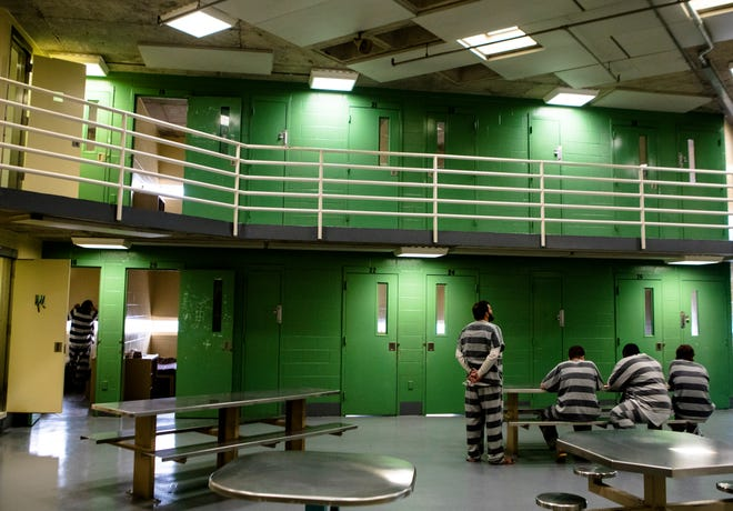 A few inmates remain in a cell block during the cell blocks work shift at the Hamilton County Jail on Monday, July 15, 2019.