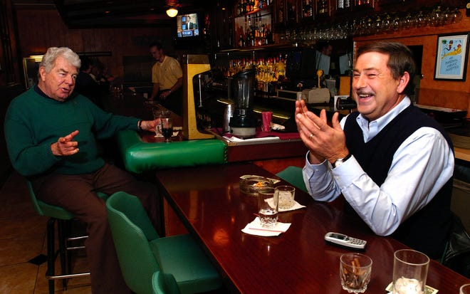 """At the famous Sorrento's in Reading, at the """"bull bar,"""" John Pfeifer of West Chester, right, shares a laugh with Ray Rusche (left), an 83 year resident and fixture at Sorrento's Thursday, Jan. 8, 2004."""
