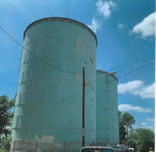 A screenshot of a photo in a Ohio EPA report shows Norwood's two water storage tanks in May. The tanks have been taken out of service after a dead bird was found in one tank and holes in the roof and corrosion was found in both tanks.