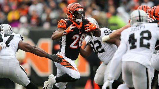 Cincinnati Bengals running back Joe Mixon (28) carries the ball in the second quarter of a Week 15 NFL football game against the Oakland Raiders, Sunday, Dec. 16, 2018, at Paul Brown Stadium in Cincinnati.