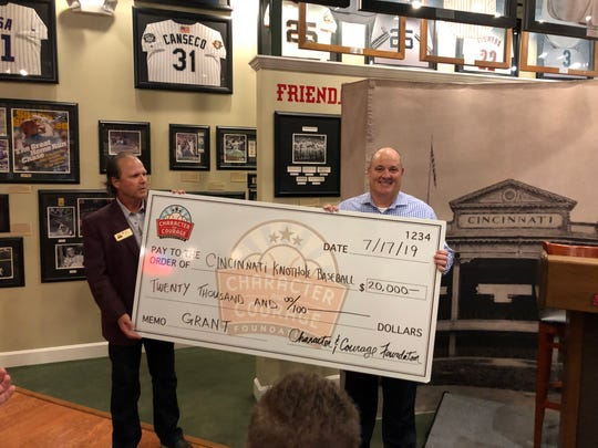 Knothole Baseball's Jeff Wiles (right) accepts a $20,000 grant from Character and Courage Foundation team members on Wednesday night.