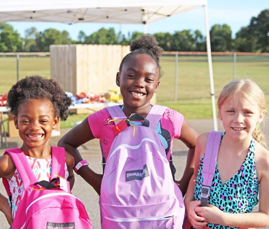 Students receive backpacks full of grade-appropriate school supplies.