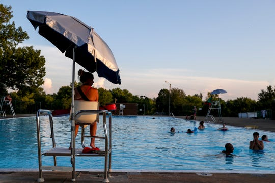 A lifeguard watches over residents while visitors play in the pool at Bel-Aire swimming pool in Clarksville, Tenn., on Wednesday, July 17, 2019.