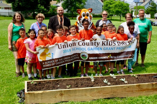 "School No. 10 Principal David Walker, third from left, with students, teachers, and representatives of the Union County ""Kids Dig In!"" program as the school's garden was being installed on Friday, May 31."