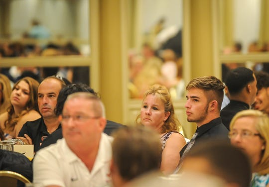 Matt Cinelli of Woodbridge, right, looks on during the Autoland Classic banquet at the Pines Manor in Edison on July 17, 2019.