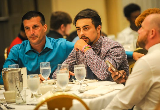 Michael DeSantis of South River, center, looks on during the Autoland Classic banquet at the Pines Manor in Edison on July 17, 2019.