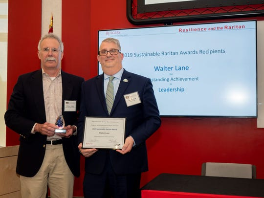 Somerset County Planning Director Walter C. Lane (right), accepts a Sustainable Raritan River Award from Bill Kibler, director of policy for the Raritan Headwaters Association and a member of the awards committee.