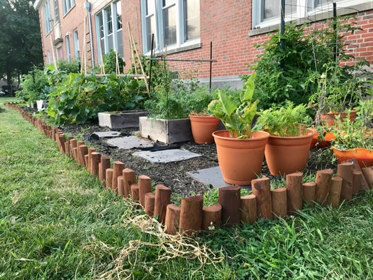 McManus Middle School beautified its garden this summer with the addition of wooden-post edging.