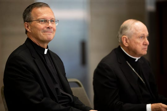Bishop-elect Fr William Joensen of Dubuque, left, smiles before he is formally introduced as the successor to Bishop Richard Pates on Thursday, July 18, 2019, in Des Moines. Joensen was born in Waterloo and will be the tenth bishop of the Des Moines Diocese.