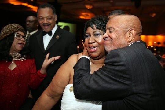Berry Gordy hugs Aretha Franklin while Jesse Jackson and a guest looks on at the Motown 50 Golden Gala Live it Again Weekend at the Renaissance Center in Detroit on Nov. 21, 2009.