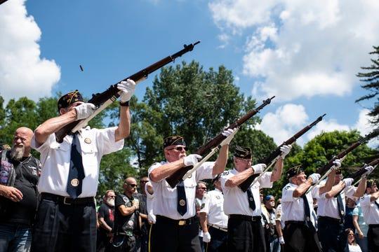Veterans perform a gun salute during his memorial service of Vietnam War veteran Wayne Wilson at the Silverbrook Cemetery in Niles, Mich., Wednesday, July 17, 2019.