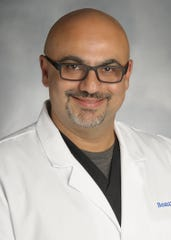 Dr. Arash Armin, chief of the department of Emergency Medicine and Chief of Staff at Beaumont Hospital,Trenton.