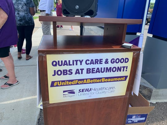 An SEIU union sign on the podium at a rally of workers and union members at Beaumont Hospital Wayne on Wednesday, July 17.