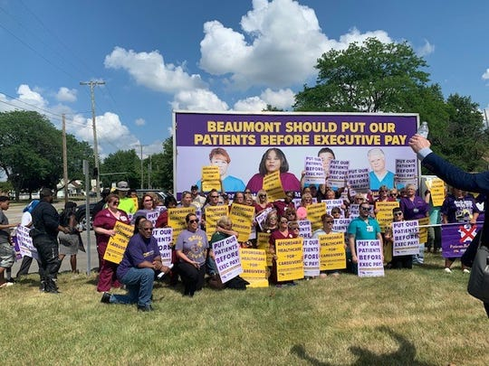 A group of workers and SEIU union members rallies outside Beaumont Wayne Hospital on Wednesday.