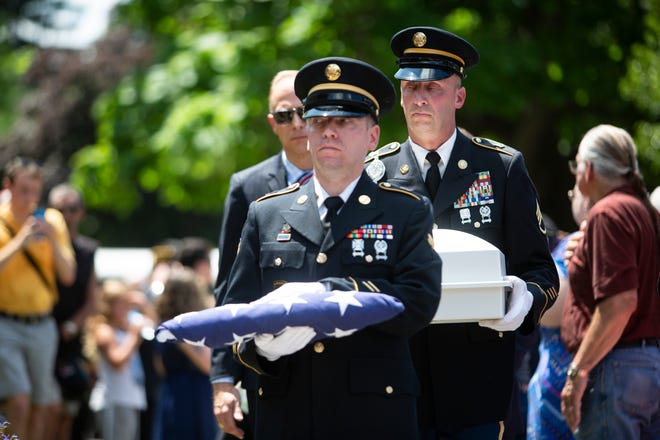 U.S. Army members carry a folded flag along with the remains of Vietnam War veteran Wayne Wilson during his memorial service at the Silverbrook Cemetery in Niles, Mich. on Wednesday, July 17, 2019.