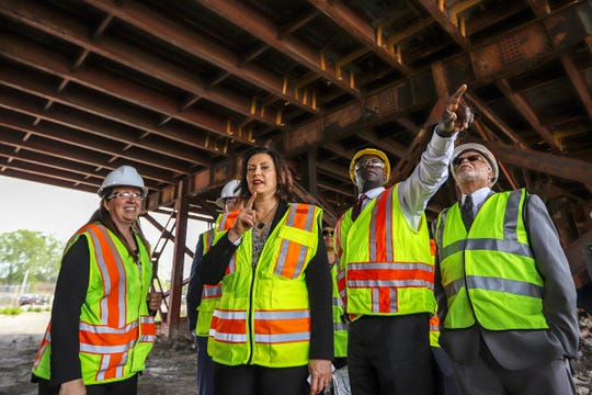 Michigan Department of Transportation Deputy Chief Bridge Engineer Rebecca Curtis, left, gives a tour to Michigan Governor Gretchen Whitmer, MDOT Director Paul Ajegba and Wayne County Executive Warren Evans of the Miller road bridge in Dearborn, Mich. to inspect the bridge on Thursday, May 16, 2019. Governor Whitmer toured the bridge to address public safety concerns and and the need for increased funding to fix Michigan's crumbling infrastructure.