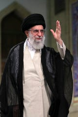 ISupreme Leader Ayatollah Ali Khamenei waves during a meeting with a group of clerics, in Tehran, Iran, Tuesday, July 16, 2019.