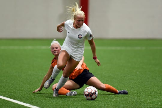 Motor City FC midfielder Civana Kuhlmann gets past a Detroit Sun defender during the Milk Cup final on Tuesday night.
