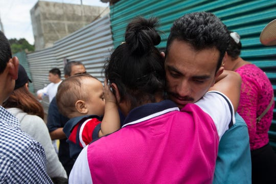 A Guatemalan migrant, who was deported from the United States, embraces relatives after arriving at the Air Force Base in Guatemala City, Tuesday, July 16, 2019.