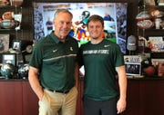 Wheaton (Ill.) Warrenville South High's Jack Olsen meets with MSU coach Mark Dantonio.
