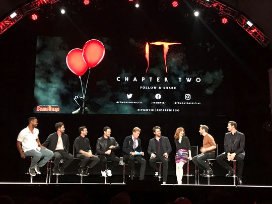 "Casts of ""It: Chapter Two"" sit at a Comic-Con event Wednesday night, July 17, 2019 at the Spreckels Theater in San Diego, Calif. They are, from left to right, Isaiah Mustafa, Andy Bean, James Ransone, Bill Hader, Conan O'Brien, Andy Muschietti, Jessica Chastain, James McAvoy, Jay Ryan."